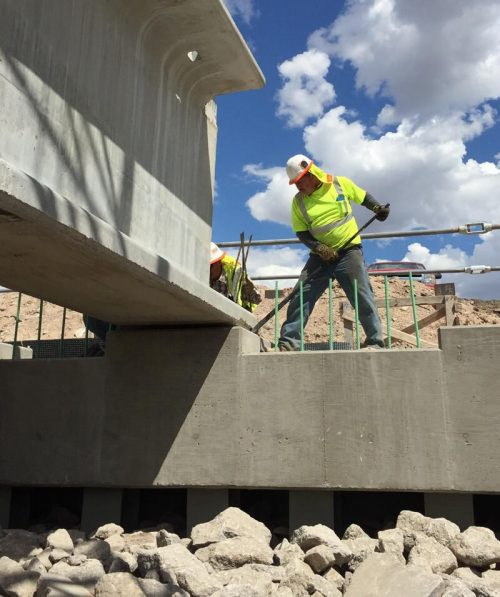 Team member working on a bridge installation